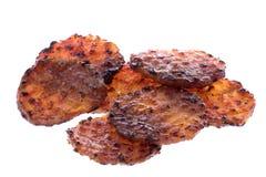монетки цыпленка барбекю зажгли изолировано стоковая фотография rf