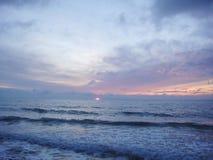 Море в заходе солнца Стоковые Фото