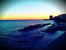 Море и заход солнца стоковое фото rf