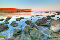 море ландшафта облицовывает заход солнца Стоковые Изображения RF