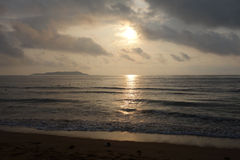 Море на восходе солнца Стоковое Фото
