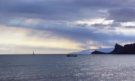 Море на заходе солнца Стоковая Фотография