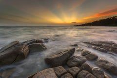 Море на заходе солнца Стоковые Изображения