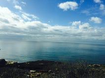 Море неба, и земля Стоковая Фотография