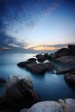 море облицовывает заход солнца Стоковое Фото