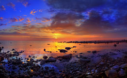 море облицовывает заход солнца Стоковые Изображения RF