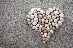Море обстреливает сердце Стоковые Фото