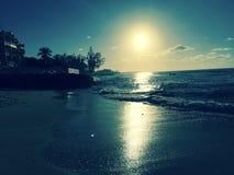 Море песка захода солнца Стоковая Фотография