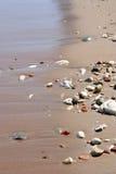 море песка камушков Стоковая Фотография