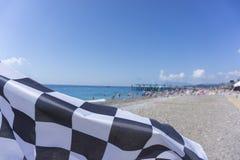 море пляжа красивейшее Заканчивая флаг на пляже Стоковое Изображение