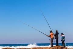 Море сини утесов штаног рыболовов Стоковые Фото