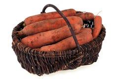 Моркови в плетеной корзине стоковые изображения