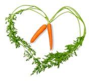 2 моркови в форме сердца на белой предпосылке Стоковое Изображение