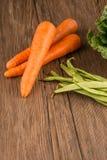 Моркови и зеленые фасоли стоковые фото