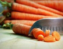 Моркови на разделочной доске Стоковые Изображения RF