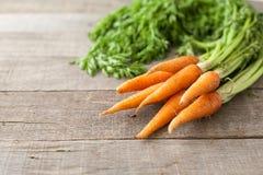 морковь на деревянной предпосылке Стоковая Фотография RF