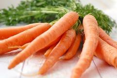 морковь на деревянной предпосылке Стоковые Изображения RF