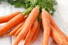 морковь на деревянной предпосылке Стоковое Изображение