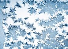 Морозная картина на стекле окна зимы Стоковое Фото