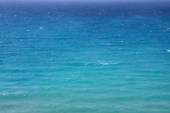 Морская вода бирюзы развевает предпосылка Стоковые Изображения