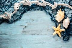 Морские звёзды, seashell и морская сеть Стоковое Изображение