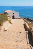 Морское побережье и церковь Порту-Torres, Италия Стоковые Фото