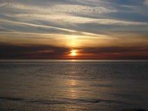 Морской заход солнца стоковые изображения