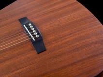 Мост акустической гитары крупного плана Стоковые Фотографии RF