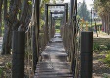 Мост веревочки в парке Стоковые Фото