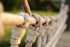 Мост веревочки в саде деревни Стоковая Фотография RF
