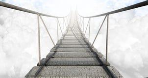 Мост веревочки над облаками стоковая фотография rf