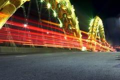 Мост вечера с красным освещением в Danang, Вьетнаме Стоковые Фотографии RF