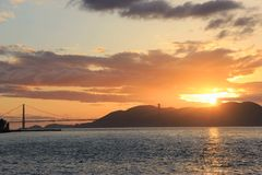 Мост золотого строба Сан захода солнца Fancisco Калифорния стоковая фотография rf