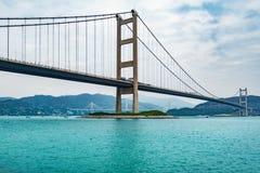 Мост к острову парка на времени дня стоковое изображение rf
