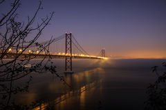 Мост 25-ое апреля Стоковое Изображение