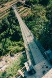 Мост Chomrong, на треке базового лагеря Annapurna, Непал Стоковые Фотографии RF