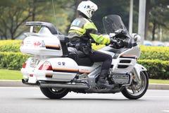 Мотор китайской полиции управляя Стоковые Фото