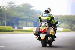 Мотор китайской полиции управляя Стоковая Фотография RF