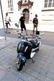 Мотоцилк и конькобежцы Стоковые Изображения