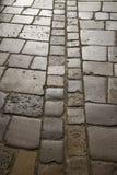 Мощенные булыжником предпосылка или текстура мостоваой Стоковые Фотографии RF