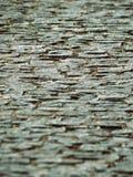 Мощенный булыжником фокус переноса наклона дороги в центре Стоковое Изображение RF