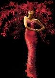 Модельная женщина одетая в красном платье Стоковая Фотография
