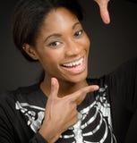 Модельный обрамлять с пальцами стоковая фотография