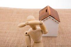 Модельный дом и человек вычисляют на холсте Стоковое Фото