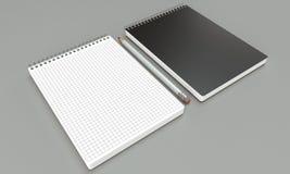 Модель-макеты тетради на яркой предпосылке Стоковое фото RF