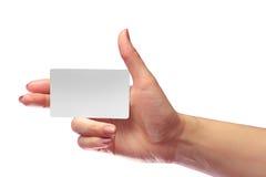 Модель-макет карточки правого женского пробела владением руки белый SIM клетчатое Стоковые Изображения RF