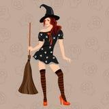 Модная ведьма с метельщиком Стоковая Фотография
