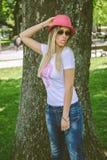 Модная девушка показывая язык Стоковые Изображения RF