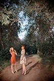 Модные женщины в парке Стоковое фото RF