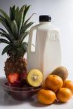 Молоко и смешивание приносить на белизне Стоковая Фотография RF
